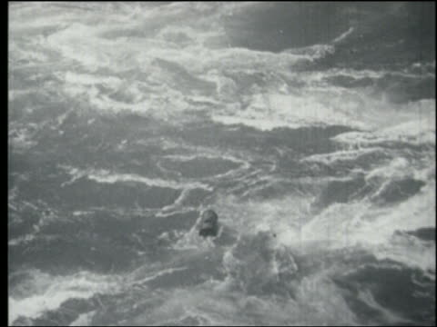 b/w 1930s/40s high angle tracking shot metal barrel floating in rapids / niagara falls - niagara falls stock videos and b-roll footage