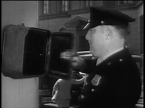 b/w 1930s/40s policeman running to + opening police emergency call box / talks on telephone - telephone box stock videos & royalty-free footage