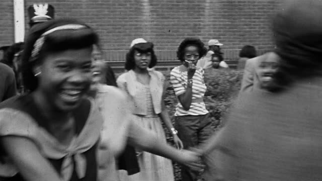 1940s - 1950s black and white medium shot female high school students playing ring around the rosy  / tulsa, oklahoma - african american ethnicity stock videos & royalty-free footage