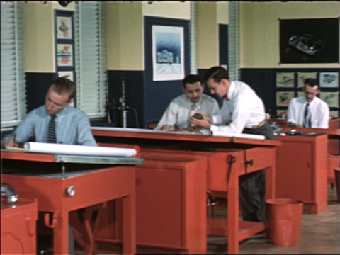 vidéos et rushes de 1940s / 50s car designers working at drafting tables / man joins other man + discusses model with him - seulement des hommes