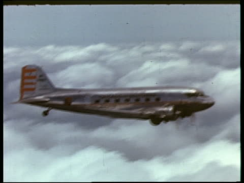 aerial 1940s / 50s chicago and southern prop plane flying above clouds - propeller aeroplane stock videos & royalty-free footage