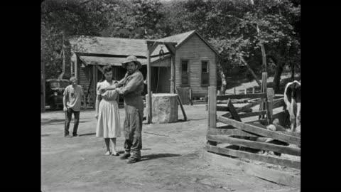 vidéos et rushes de 1940s a stone faced farmer instructs man to get his gun for him - péquenaud