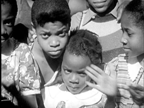 b/w montage 1940s african-american boy dancing encircled by children clapping hands / new york city, new york - boys stock videos & royalty-free footage
