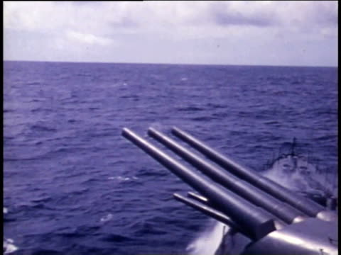 1940s antiaircraft guns firing from moving ship - aircraft carrier stock videos & royalty-free footage