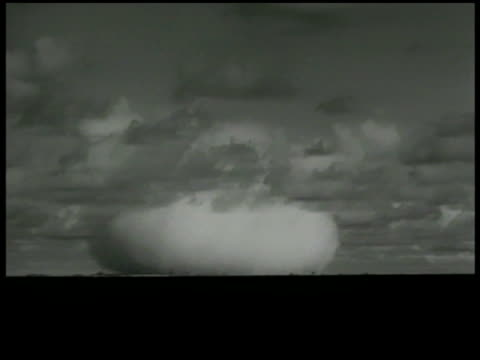 atomic bomb xws nuclear bomb exploding explosion goes up base explodes outward wide lifting upward xws nuclear explosion rising in air location - nuclear bomb stock videos & royalty-free footage