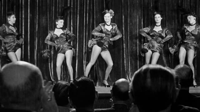 1940s audience point of view legs of chorus girls dancing on stage / backs of heads of men in audience - burlesque stock videos & royalty-free footage