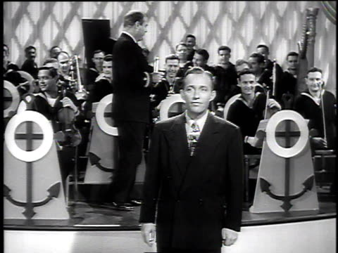 stockvideo's en b-roll-footage met 1940s bing crosby performs in front of a coast guard band / united states - bing crosby