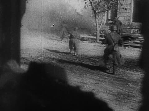 1940s black and white long shot russian soldiers running with guns through the streets and firing / leningrad - st. petersburg russia stock videos & royalty-free footage