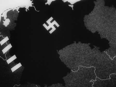 1940s black and white map of europe with swastika on nazi empire / animated lines representing attack on germany - nazi swastika stock videos and b-roll footage