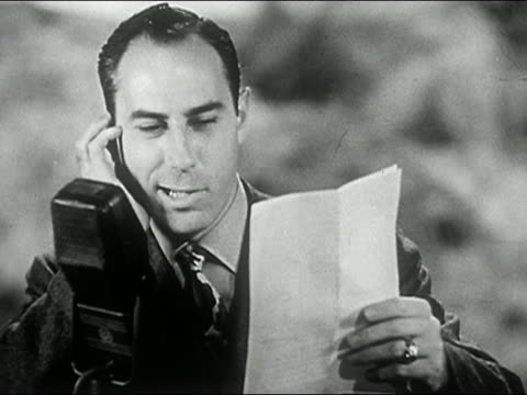 vídeos de stock, filmes e b-roll de 1940s black and white medium shot broadcaster (bill stern) reading from script and talking into microphone - apresentador