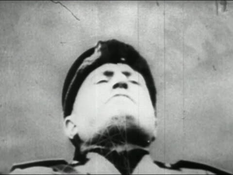 """1940s black and white mussolini giving speech/ dissolve to animation of radio tower transmitting the word """"lies"""" - benito mussolini stock videos & royalty-free footage"""