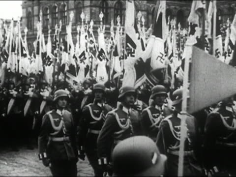 1940s black and white nazis carrying flags and goose stepping in military parade for hitler - marching stock videos & royalty-free footage