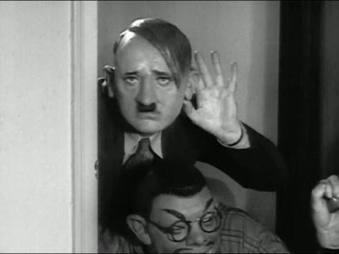 1940s black and white two people wearing masks of hitler and stereotypical caricature of japanese man in doorway - stereotypical stock videos & royalty-free footage