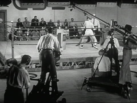 1940s black and white wide shot tv crew shooting boxing match - boxing ring stock videos and b-roll footage