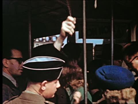 1940s bus conductor ringing bell as people are boarding crowded bus / bus pulling away on place de l' opera / paris - avenue de l'opera stock videos & royalty-free footage