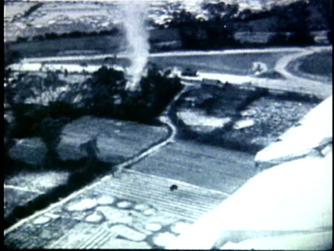 1940s b/w aerial ws french military plane flying over countryside with bomb damage below during early years of fench indochina war / vietnam - french army stock videos & royalty-free footage