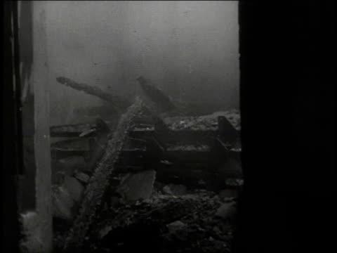 vídeos de stock, filmes e b-roll de 1940s b/w aftermath of air raid / germany - air raid
