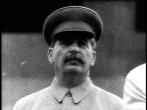 vídeos de stock e filmes b-roll de 1940s b/w joseph stalin standing / russia - joseph stalin