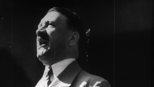 vídeos de stock, filmes e b-roll de 1940s b/w montage adolf hitler having speech / germany - adolf hitler