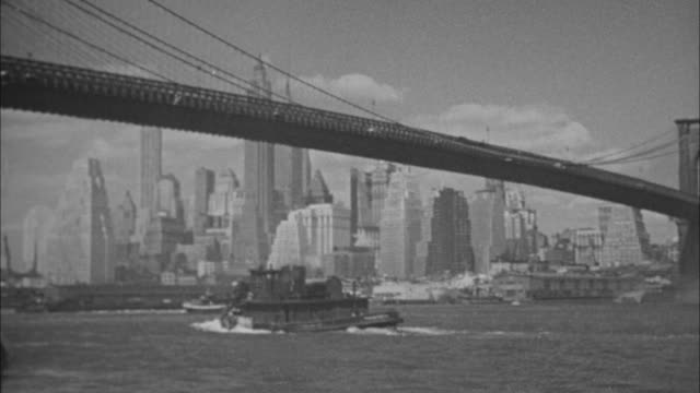 stockvideo's en b-roll-footage met 1940s b/w montage boats passing under brooklyn bridge, manhattan skyline in background / new york city, new york, usa - 1930
