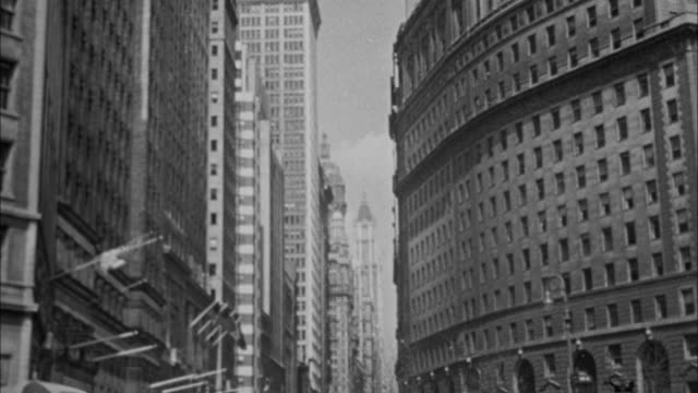1940s B/W MONTAGE Buildings and parade on Broadway / New York City, New York, USA