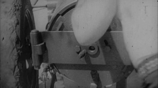stockvideo's en b-roll-footage met 1940s b/w montage cannon ball is fired into chest of man / united states - kanon