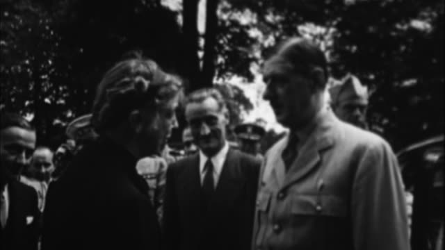1940s b/w montage charles de gaulle talking to woman and laying wreath / france - charles de gaulle stock videos & royalty-free footage