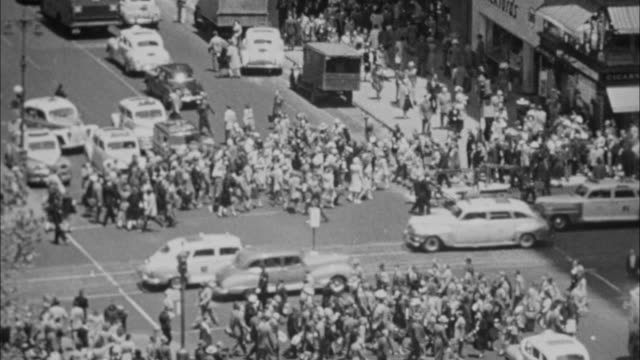 1940s B/W MONTAGE Crowded 42nd, New York Public Library / New York City, New York, USA