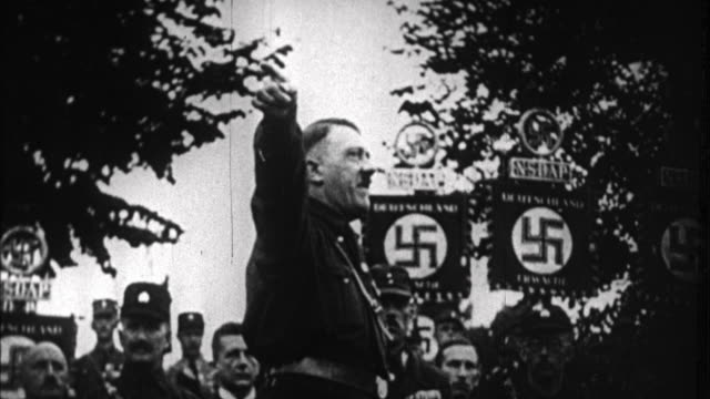 1940s B/W MONTAGE Early shots of Adolf Hitler as he rising to power / Germany