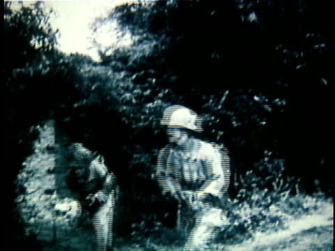 1940s b/w montage french soldiers on patrol in jungle during early years of french indochina war / vietnam - french army stock videos & royalty-free footage