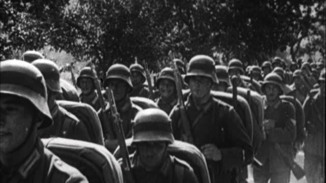 1940s b/w montage germans army marching / germany - 荷車点の映像素材/bロール
