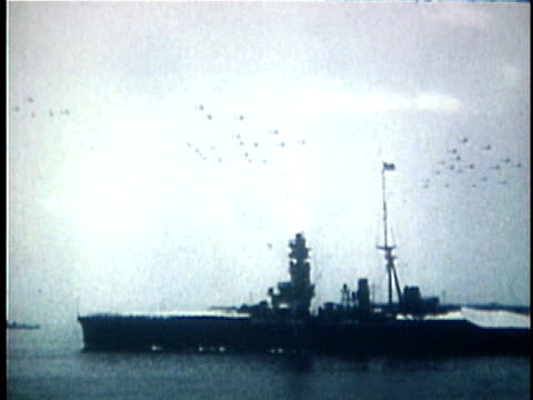 1940s b/w montage japanese naval fleet and artillery bombardment / japan - battle stock videos & royalty-free footage