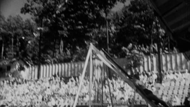 1940s b/w montage man is launched into pool via rubber band / united states - catapult stock videos & royalty-free footage