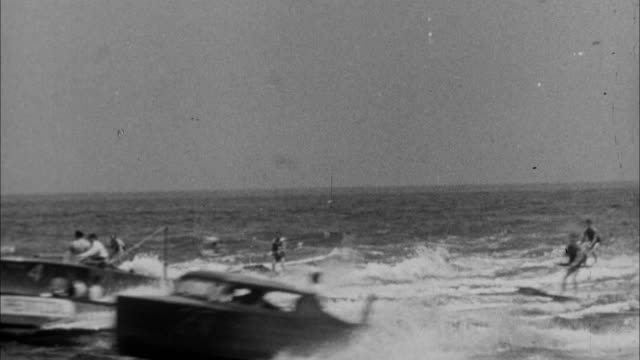 1940s B/W MONTAGE People being pulled on surf boards behind boats / United States