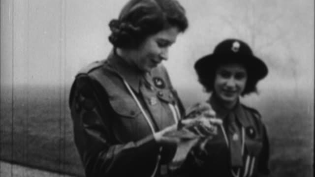 1940s b/w montage queen elizabeth works during war / united kingdom - one animal stock videos & royalty-free footage