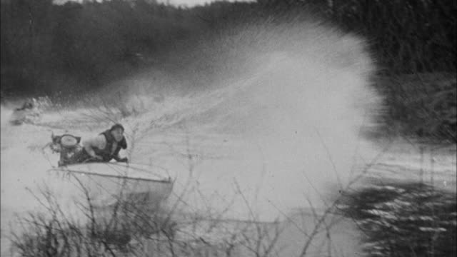 1940s b/w montage small boats race around river / united states - acquascooter video stock e b–roll