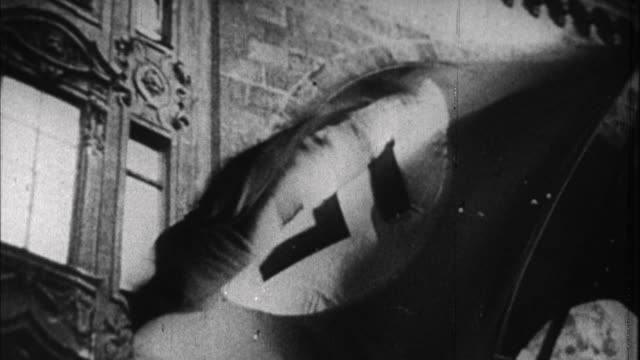 1940s b/w cu nazi flag flapping in wind on building / germany - nazi swastika stock videos and b-roll footage