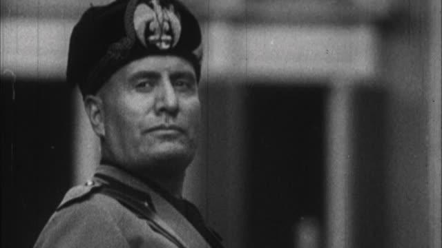 1940s b/w cu portrait of benito mussolini / italy - benito mussolini stock-videos und b-roll-filmmaterial
