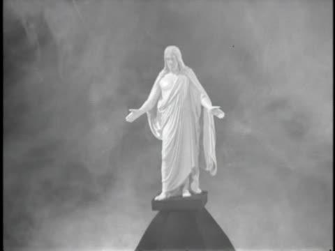 1940s B/W MS ZI CU Statue of Christ in fog / USA