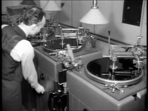 1940s B/W technician operating recording equipment / United States