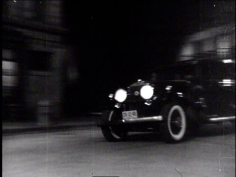 1940s TS car crashing and flipping over on a street at night