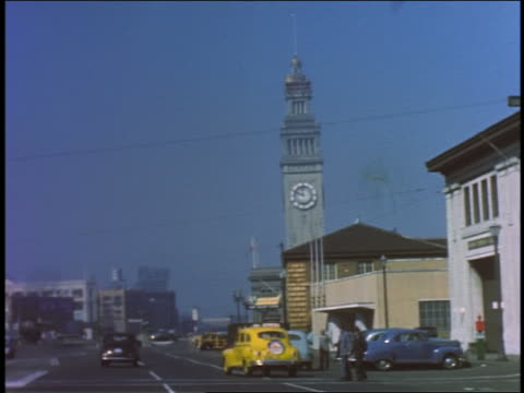 1940s car point of view driving on the Embarcadero towards the Ferry Building / San Francisco