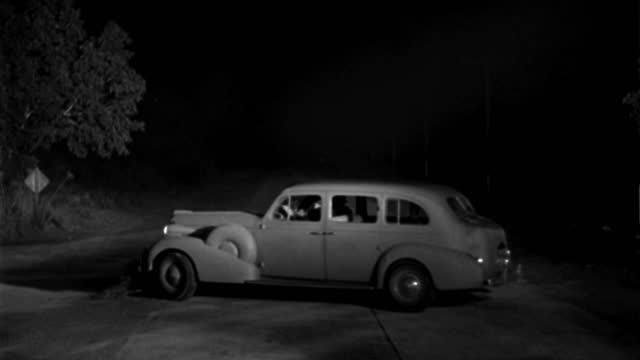 a 1940s car runs a second car off a road, turns around and flees in the opposite direction. - 1941 stock videos & royalty-free footage