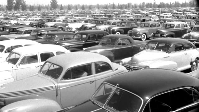 1940s cars occupy a crowded parking lot. - 1943 stock videos & royalty-free footage