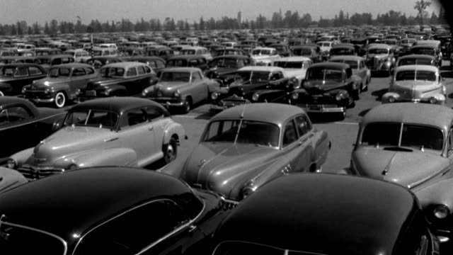 1940s cars occupy a large parking lot. - 1943 stock videos & royalty-free footage