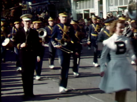 1940s ms, cheerleaders and high school marching band marching in parade, elkins, west virginia, usa - marching band stock videos & royalty-free footage