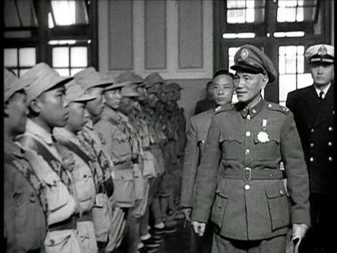 b/w 1940s chiang kaishek in uniform inspecting troops / china / documentary - chiang kai shek stock-videos und b-roll-filmmaterial