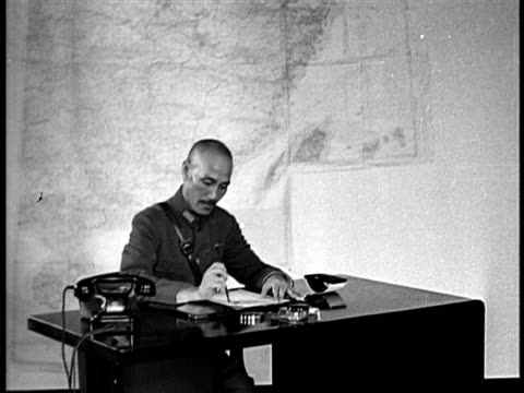 b/w 1940s chiang kaishek writing at desk / china / documentary - chiang kai shek stock-videos und b-roll-filmmaterial