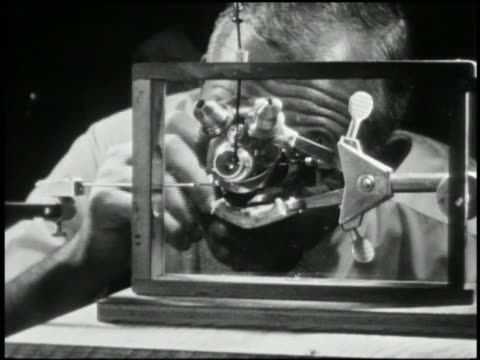 1940s close up atomic scientist looking optical device - atom stock videos & royalty-free footage