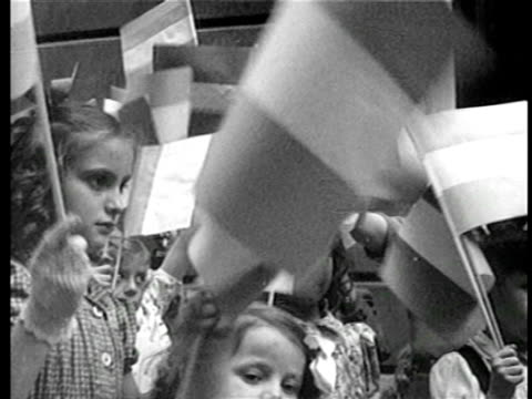 vídeos y material grabado en eventos de stock de b/w 1940s close up children waving small argentinian flags / newsreel - bandera argentina